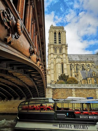 Bridge Bridge - Man Made Structure Close-up Perspective Boat Tourism Restaurant Boat Visiting Paris Paris ❤ Notre Dame De Paris City History Architecture Building Exterior Built Structure Cloud - Sky Place Of Worship Cathedral Religion Spirituality
