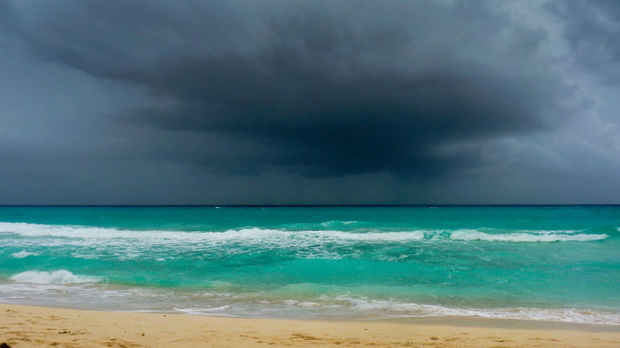 Storm on turquoise ocean in Playa Del Carmen, Yucatan, Mexico Beach Beauty In Nature Blue Cloud Danger Horizon Over Water Majestic Mexico Nature Ocean Playa Playa Del Carmen Sand Scenics Sea Seascape Sky Stone Summer Tropical Turquoise Water Wave Wind Yúcatan