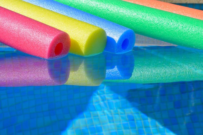 Full frame shot of multi colored toy on swimming pool