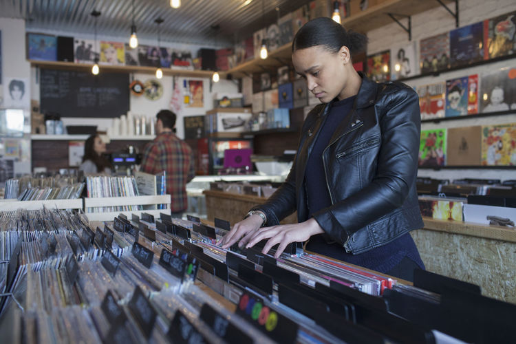 Young woman in a record store