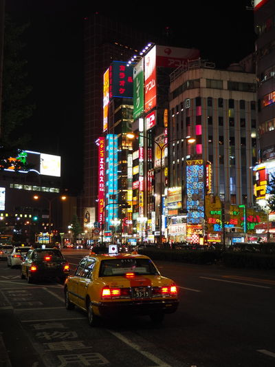 Advertisement Architecture Building Exterior Built Structure Car City City Lights Illuminated Land Vehicle Multi Colored Neon Night No People Outdoors Road Shinjuku Street Tokyo Tokyo Night Transportation