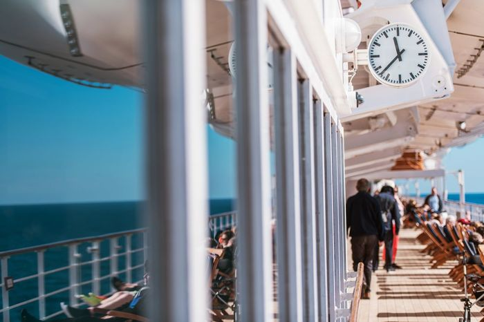 Cruise Ship Travel. Vessel Main Deck. Outside Clock. Cruising Theme. Cruise Ship Travel Travelling Clock Clock Face Clock Tower Day Deck Indoors  Large Group Of People Men Ocean People Real People Sea Travel Ship Sky Time Time To Reflect Vessel Water Women