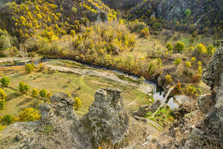 I didn't have much time this weeks so I will upload now rest of my photos from Vrazji kamen. This is photo of bridge from 60 m high rock. Vrazji kamen (devil's rock) on south-eastern Serbia , near borders with Bulgaria and Macedonia. This natural phenomenon are made by erosion of river Pcinja. But more interesting is local legends about this place. People said that devils had wanted to change course of the river and because of that during the night they were throwing big rocks in the river. But they didn't succeed. Then they found one big rock from place nearby and they wanted to move it in the river, but rock was heavy and when they came close to the river they heard sound of rosters so they left rock and got away. From this period rocks stands until today , some of them about 60 meters high. EyeEm Best Shots EyeEm Nature Lover EyeEm Gallery Aerial View Beauty In Nature Day Eye4photography  Forest Grass Hot Spring Landscape Lichen Nature No People Outdoors Plant River Rock - Object Scenics Stream - Flowing Water Tranquil Scene Tranquility Tree Water Waterfall