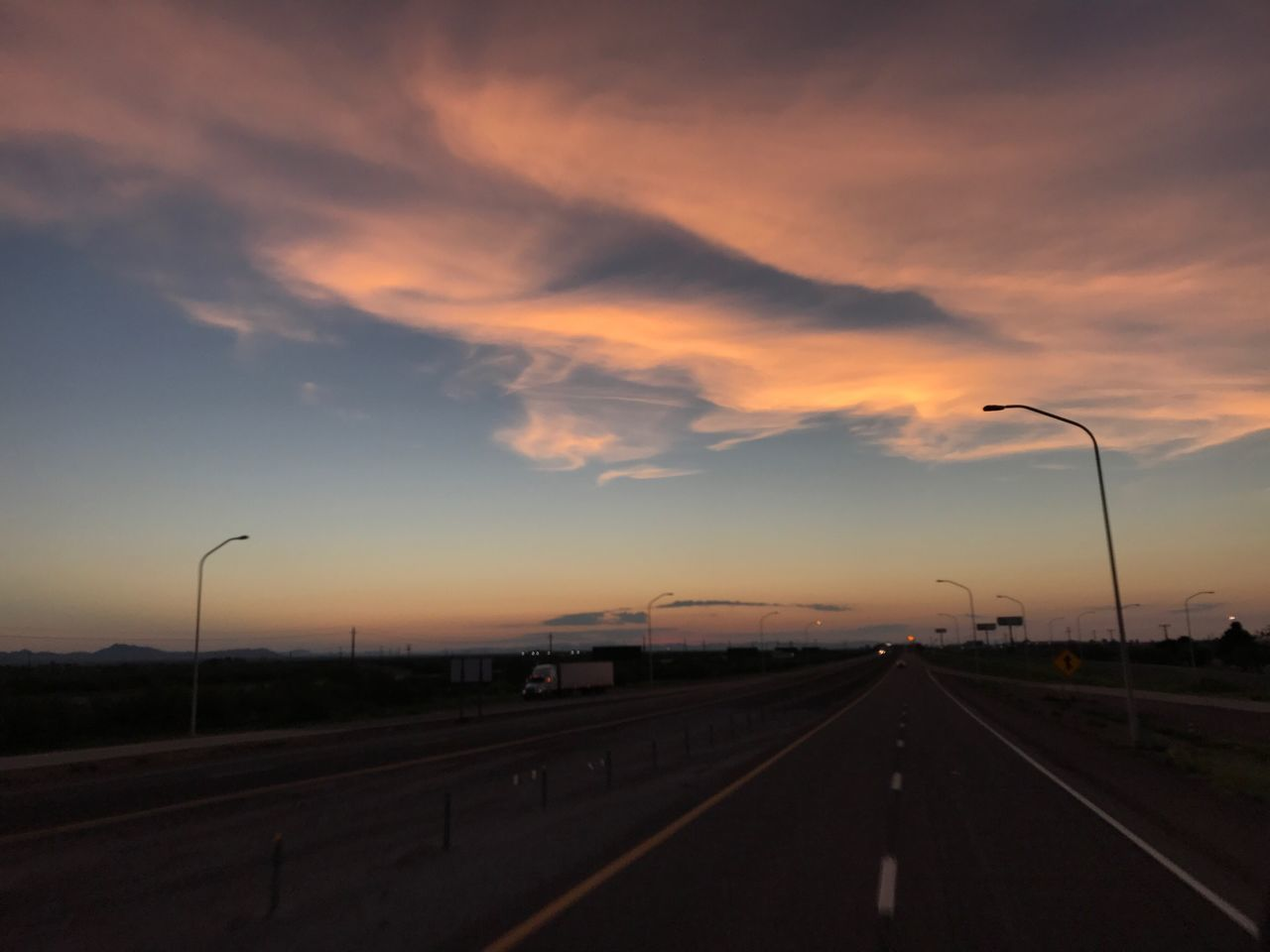 road, transportation, the way forward, sunset, diminishing perspective, street light, highway, sky, no people, cloud - sky, outdoors, scenics, nature, beauty in nature, day