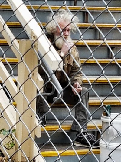 No chance of a model release from this person. Taking to himself. Growling away.... Chainlink Fence One Man Only Mature Adult One Person Casual Clothing Mature Men Beard Outdoors Men Close-up Portrait Old Man Street People
