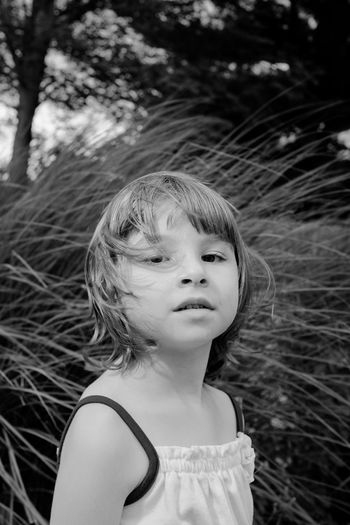 Portrait of cute girl against grass