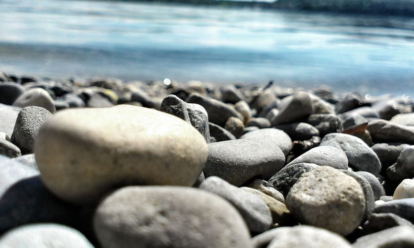 Close-up of stones on riverbank