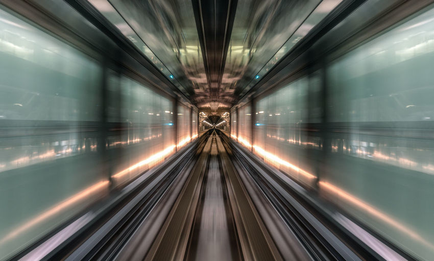 Speeding inside underground tunnel Transportation Motion Blurred Motion Rail Transportation Illuminated Long Exposure Mode Of Transportation Speed Architecture Travel The Way Forward No People Diminishing Perspective Direction Railroad Track vanishing point Subway Train Track Indoors  Futuristic