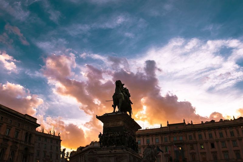 Milan Milano Architecture Cloud - Sky Sky Building Exterior Built Structure Sculpture Statue Nature Sunset History Art And Craft City Travel Destinations The Past Low Angle View Human Representation No People Representation Building Craft