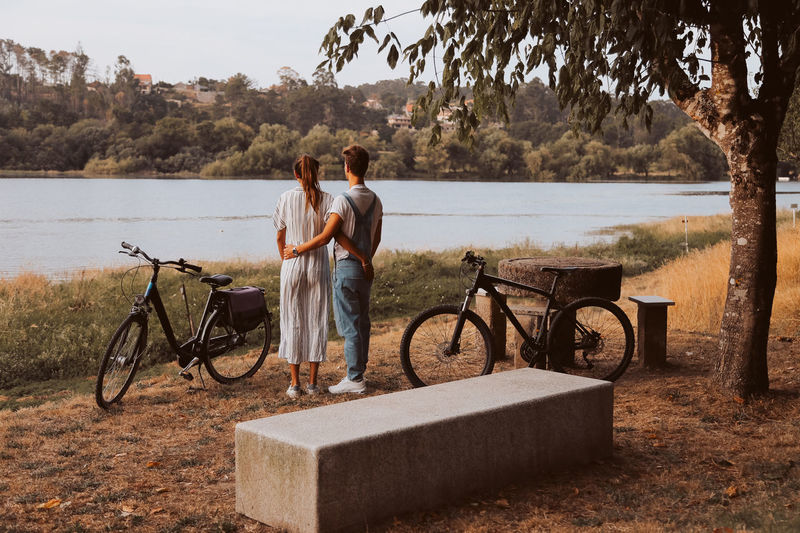 People on bicycle by lake