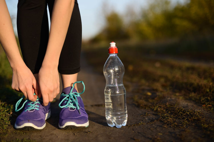 Adult Body Part Bottle Close-up Day Exercising Focus On Foreground Human Body Part Human Leg Human Limb Leisure Activity Lifestyles Nature One Person Outdoors Real People Shoe Sports Clothing Water Bottle  Women