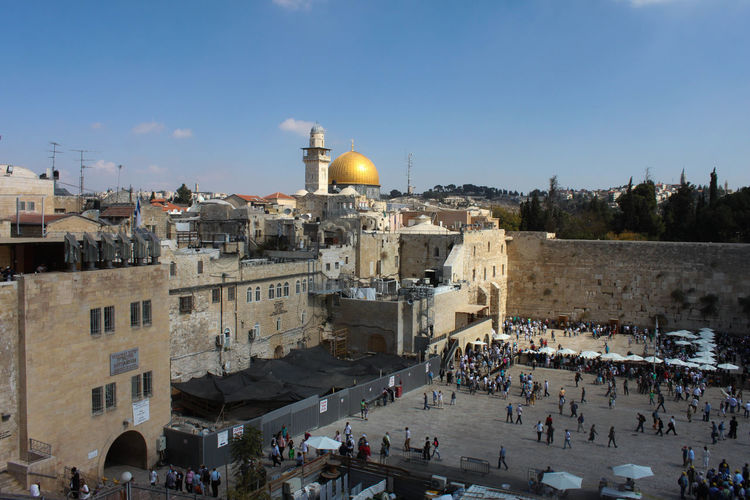 People praying at wailing wall of mosque