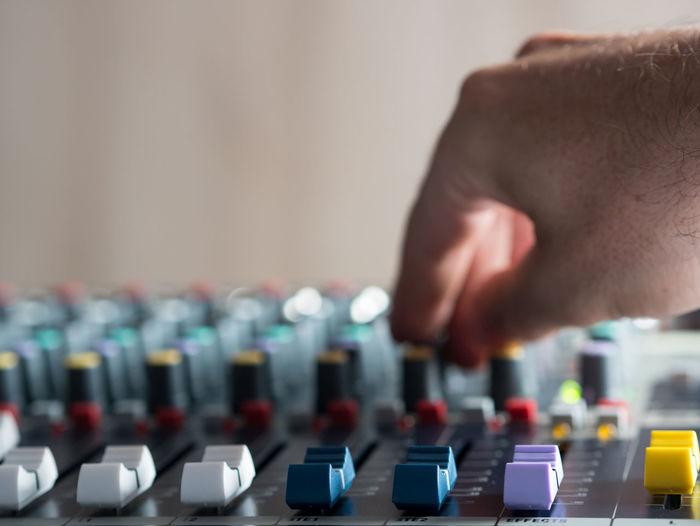 Close-up of man playing sound mixer