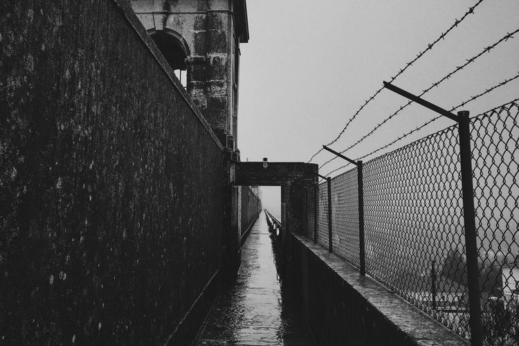 Empty Narrow Footpath On Rainy Day