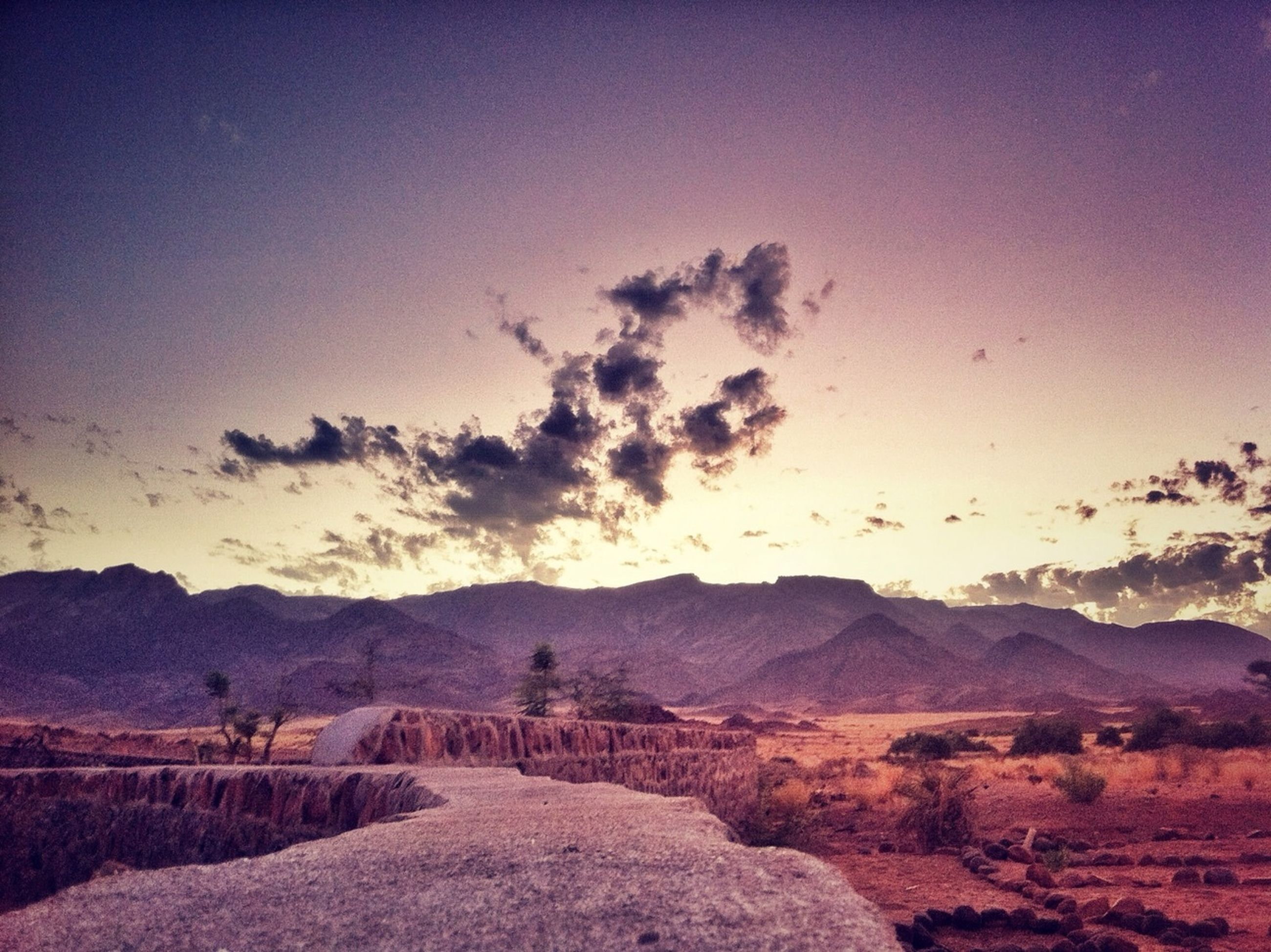 landscape, mountain, tranquil scene, tranquility, scenics, mountain range, sky, beauty in nature, nature, non-urban scene, sunset, remote, desert, horizon over land, arid climate, rock - object, cloud - sky, barren, idyllic, physical geography