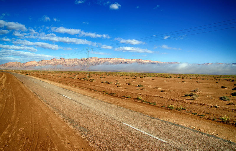 Landscape Sky Environment Road Cloud - Sky Scenics - Nature Land Tranquil Scene Tranquility Transportation Beauty In Nature Field Nature Day No People Non-urban Scene Blue Mountain Dirt Sunlight Arid Climate