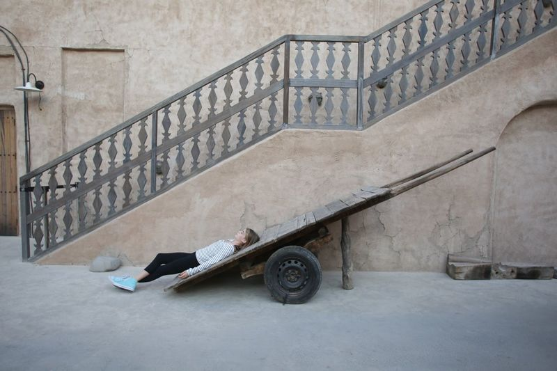 Sleeping around City Town Trade Trolley UAE Playing Dubai Joking Kid Child Built Structure Architecture Transportation Day Land Vehicle Mode Of Transportation Railing Building Exterior Outdoors Wall - Building Feature Steps And Staircases Staircase Creativity