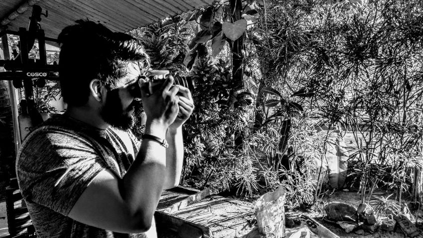 Its a Different Feeling📷🎥📸 One Person Shadow Sunlight Day Outdoors Real People Adults Only Beauty Men Photography Live Your Dream .. Share Your Passion .. Uniqueness EyeEm Best Shots Photography Themes Monochrome Photography Camera - Photographic Equipment Human Representation Portrait One Man Only Only Men Happiness Second Acts