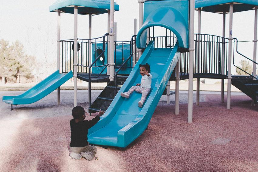 Photography Evanscsmith Photographerinlasvegas Kids Being Kids Son Playing Playground Childhood Outdoor Play Equipment Water Slide Playground Sky Slide Slide - Play Equipment Monkey Bars Swing