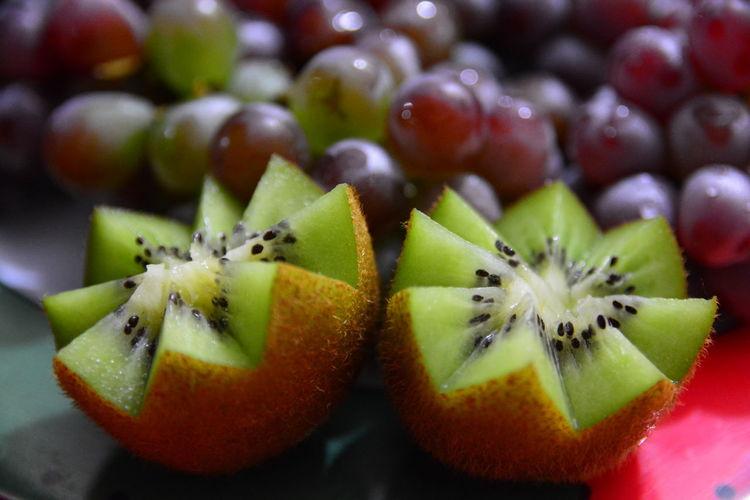 Close-up of kiwi and grapes