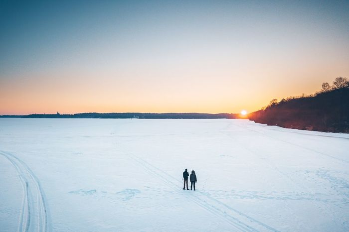 The last sun rays Aerial View Landscape Sunset Frozen Sea Winter Aerial Mavic Mavic Pro Drone  EyeEm Selects Winter Snow Sunset Cold Temperature Nature Scenics Beauty In Nature Real People Leisure Activity Tranquil Scene Two People Men Togetherness Outdoors Tranquility Landscape Vacations Silhouette Lifestyles Love Visual Creativity