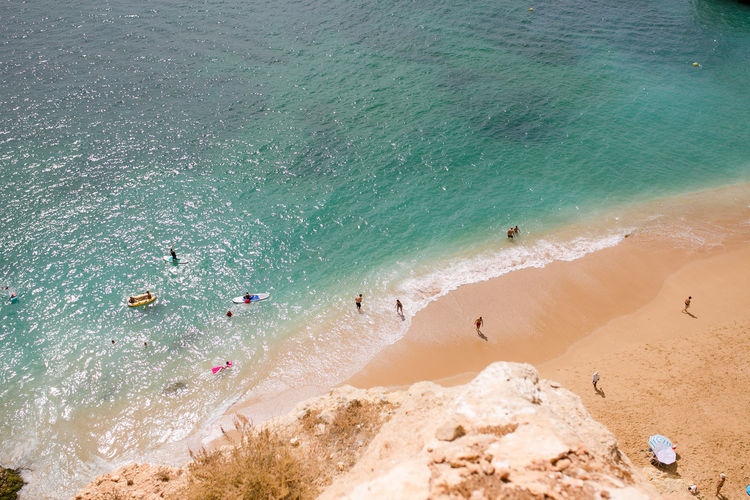 Beach from above at Praia da Marinha. Algarve Portugal Praia Da Marinha Vacations Above Beach Beachtime Group Of People High Angle View Landscape Nature Sand Turquoise Colored Water