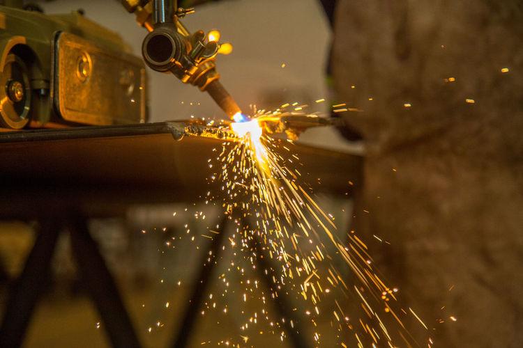 Close-Up Of Metal Cutting At Factory