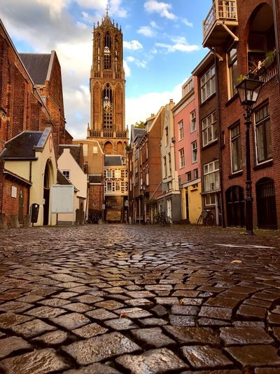 The Dom Church Tower in Utrecht viewers from the Cobbled Streets Netherlands Holland Dutch Culture Europe Trip Utrecht Building Exterior Architecture Built Structure Building City Sky Street Cobblestone Residential District Spirituality No People Surface Level Religion