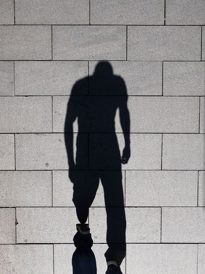 A Bird's Eye View Abstract ApeMan Focus On Shadow Footpath Lifestyles Man Pavement People Shadow Street Sunlight Unrecognizable Person Walking