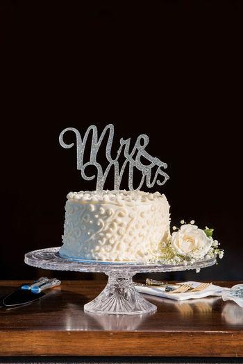 View of cake on table against black background