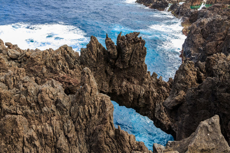 Madeira Islands, Portugal Rock Sea Water Rock - Object Solid Rock Formation Nature No People Beauty In Nature Mountain Day Land Scenics - Nature Outdoors Rough Mountain Range High Angle View Cliff Environment Formation Eroded