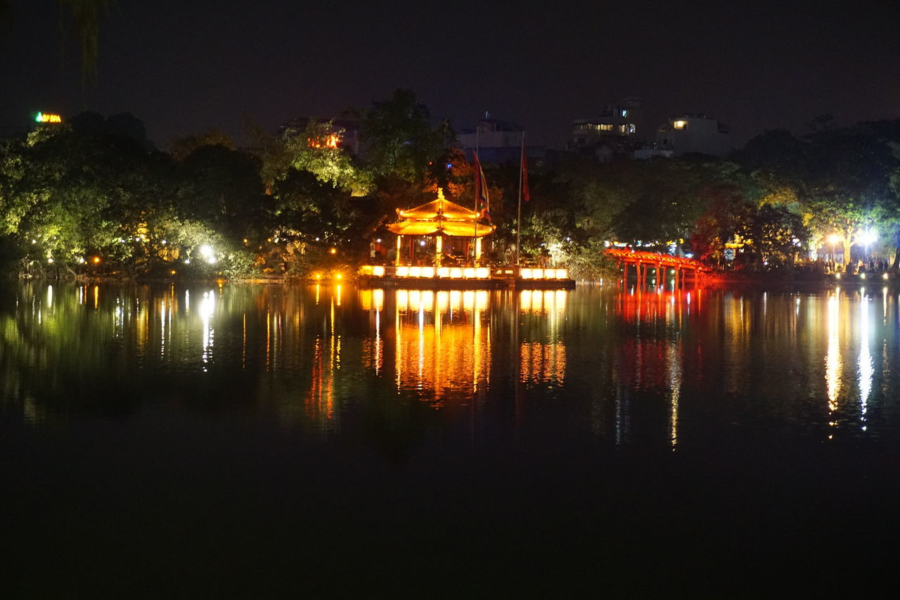 illuminated, night, water, reflection, architecture, built structure, lake, tree, no people, waterfront, outdoors, building exterior, sky