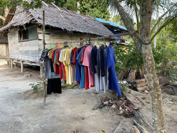Clothes drying on roof outside building