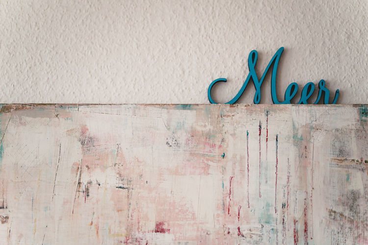 Craft Items Craftsmanship  Vintage Craft Arts And Crafts Wall - Building Feature Western Script Text Communication Built Structure No People Architecture Indoors  Wall Textured  Capital Letter Metal Single Word Graffiti Day Blue Creativity Emotion Message
