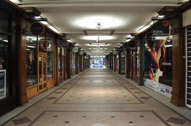 Interior Of Illuminated Corridor In Shopping Mall