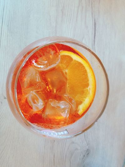 Chears Aperol Spritz Apperitif Food And Drink Food Freshness Fruit Healthy Eating Drink Still Life Orange Color Citrus Fruit Table Indoors  High Angle View Refreshment Drinking Glass Glass