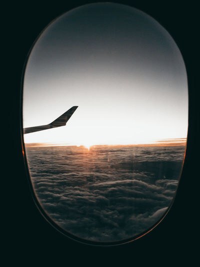 Scenic view of sunset seen through airplane window