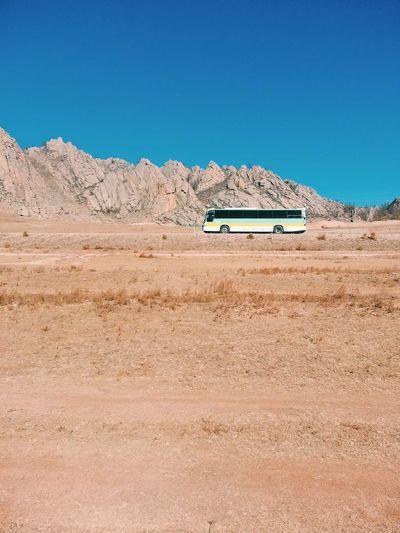 Car On Desert Against Clear Blue Sky