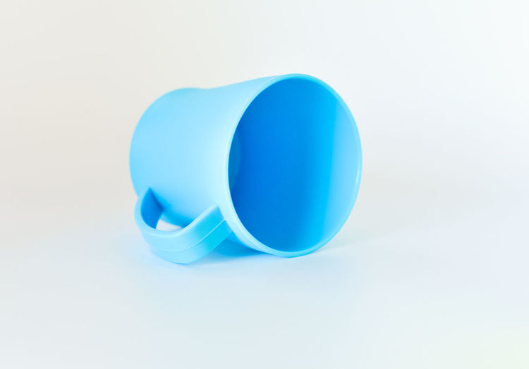High angle view of blue plastic against white background