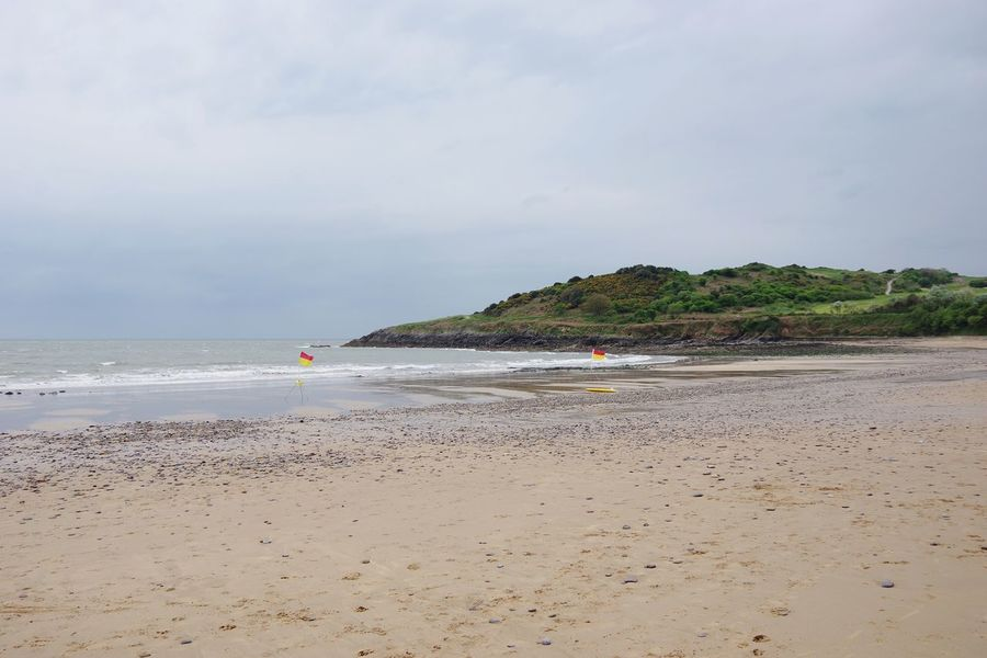 Beach Sand Sea Coastline Tranquil Scene Vacations Landscape Tourism Scenics Travel Destinations Idyllic Tranquility Cloud - Sky Nature Beauty In Nature Dramatic Sky Tourist Resort Water's Edge Awe Non-urban Scene Wales Langland Bay