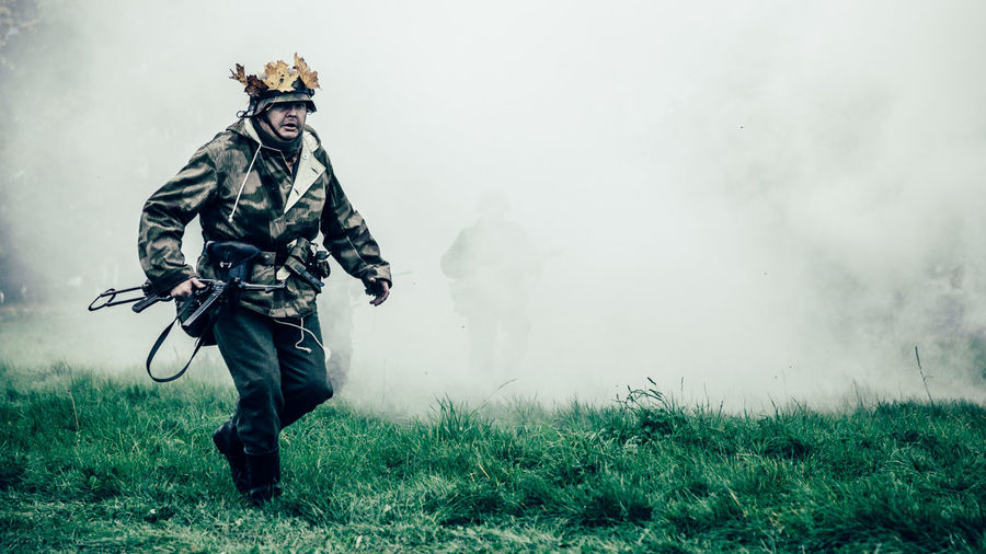 British Army Reenactment Soldier in Camouflage Running across Battlefield First Eyeem Photo
