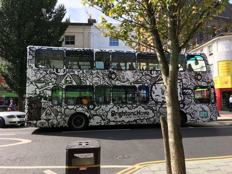 Artsy Bus in Brighton, England. Cartoon Art Double Decker Bus Design