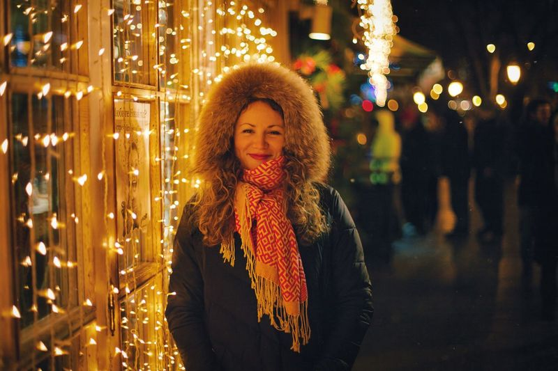 Night Redhead Illuminated Young Adult Christmas Smiling Christmas Lights Young Women Portrait Happiness Outdoors One Person Looking At Camera Focus On Foreground Winter Christmas Decoration Warm Clothing Cheerful Lifestyles Cold Temperature