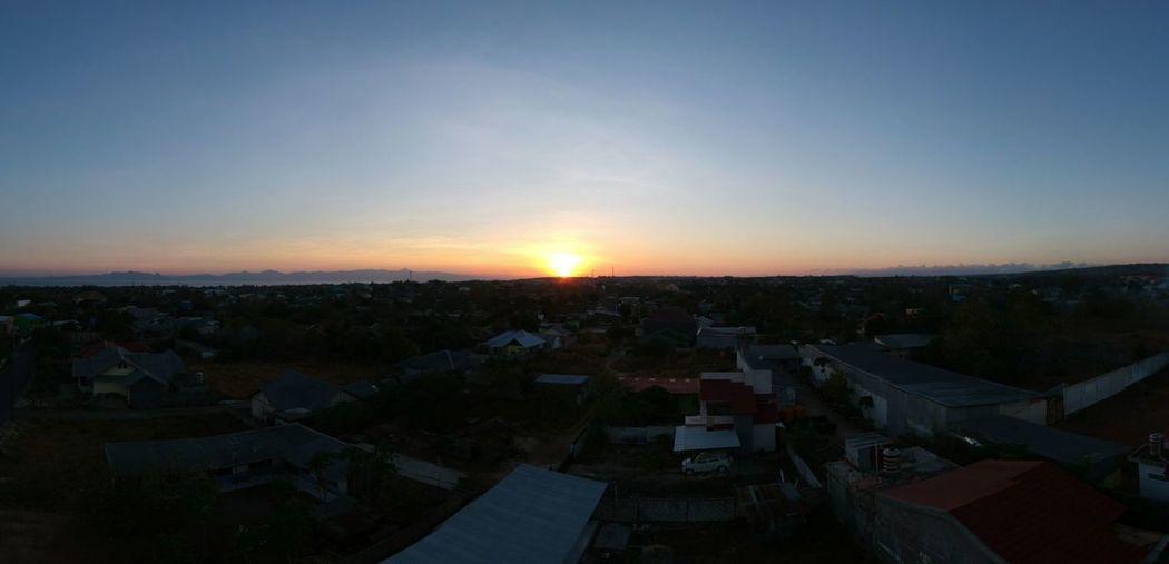 Sunrise di tanah timor.. Dronepilot Djisparkdrone Djiindonesia Sunrise Kupanglandscape Astronomy City Cityscape Tree Business Finance And Industry Urban Skyline Community Illuminated High Angle View