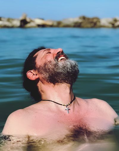 Happiness Man In The Sea Leisure Activity Real People One Person Lifestyles Shirtless Be Brave Young Men Sea