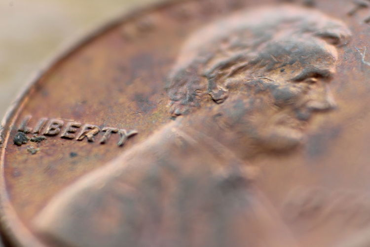 Close-up Coin Communication Currency Detail Finance Focus On Foreground Indoors  Metal Metallic No People Number Old Selective Focus Single Object Still Life Table Text Wealth Western Script