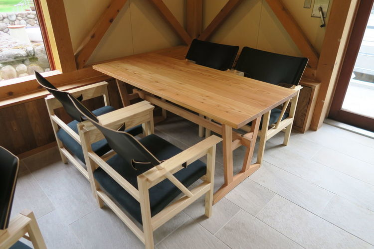 High angle view of empty chair and wooden table arranged in room