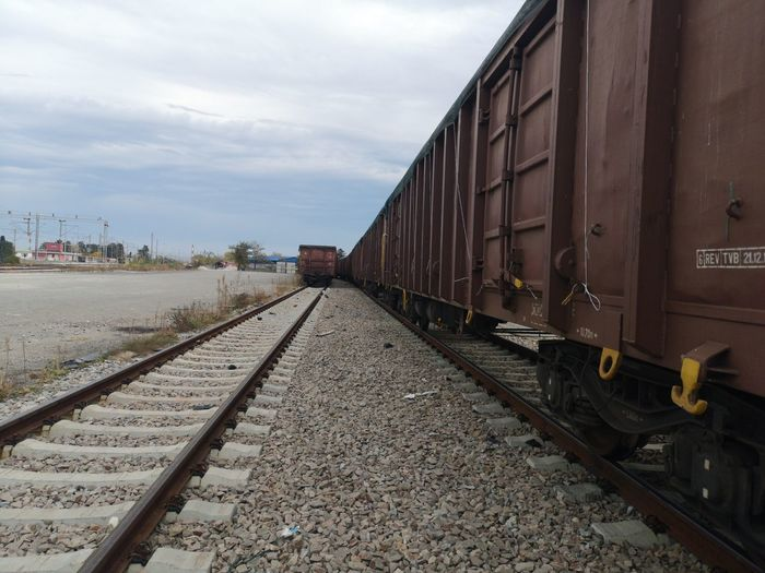 Rail Transportation Track Transportation Railroad Track Mode Of Transportation Sky Cloud - Sky Train Nature Train - Vehicle Public Transportation Day Freight Train No People Business Freight Transportation Outdoors Architecture Cargo Container Land Vehicle Shunting Yard