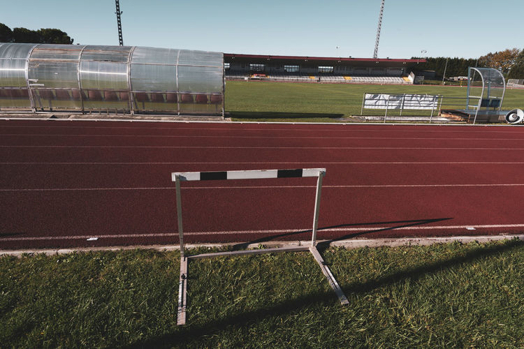 stadium running track hurdle Tartan Track Athletics Sport Running Stadium Competition Speed Lanes Grass Track And Field Running Track Nature No People Plant Sports Track Building Exterior Seat Empty Absence Playing Field Sky Outdoors Hurdle Hedge Obstacles Wooden