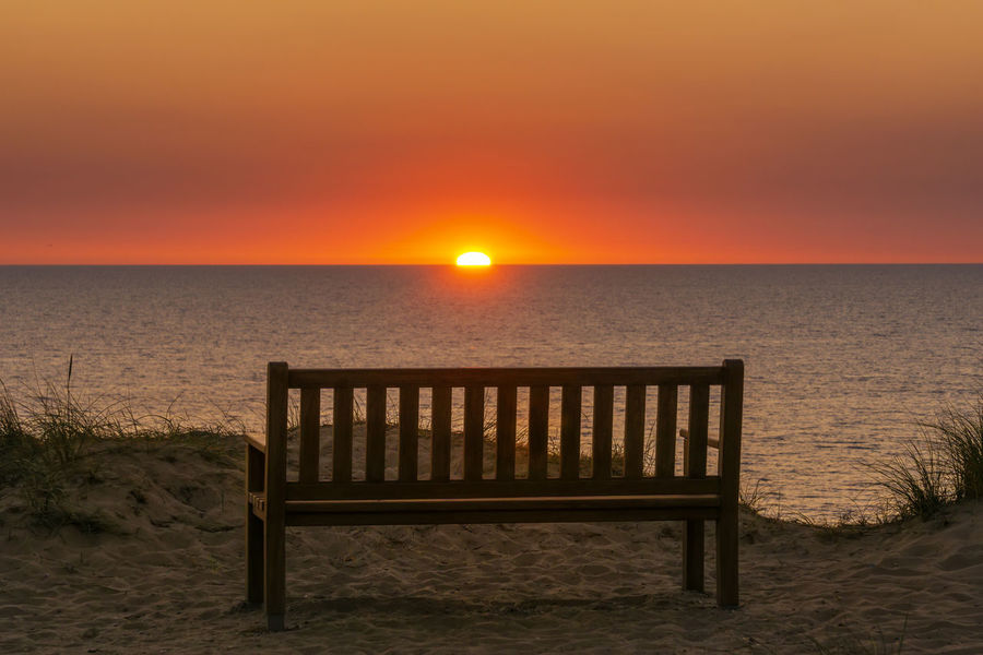 Rotes Kliff, Kampen Bench Relaxing Sonnenuntergang Sylt, Germany Beach Beauty In Nature Horizon Horizon Over Water Idyllic Nature No People North Sea Orange Color Outdoors Scenics - Nature Sea Seat Sky Sun Sunset Sylt Tranquil Scene Tranquility Vacation Destination Water